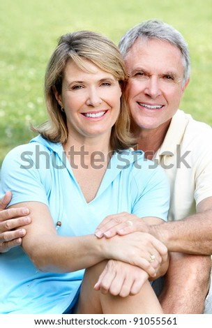 Happy senior couple in love in the park. - stock photo