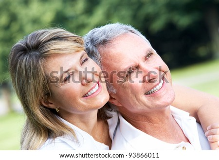 Happy senior couple in love in the park. - stock photo