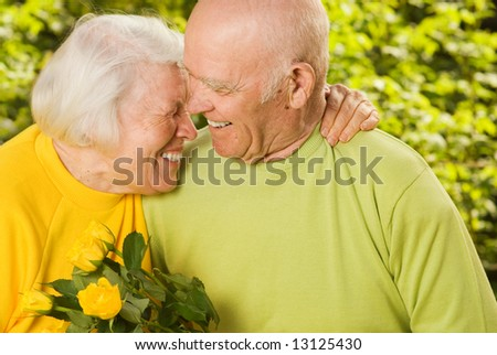 Happy senior couple in love outdoors - stock photo