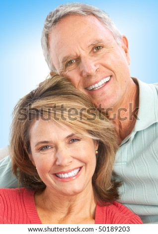 Happy senior couple in love. Over blue background