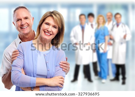 Happy senior couple in love over medical group background.