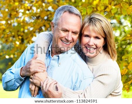 Happy senior couple in love. Park outdoors. - stock photo