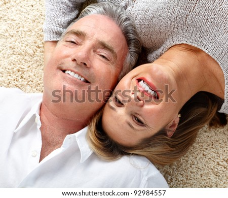 Happy senior couple in love. Relaxing at home. - stock photo