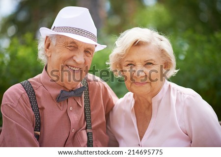 Happy senior couple in smart casual - stock photo