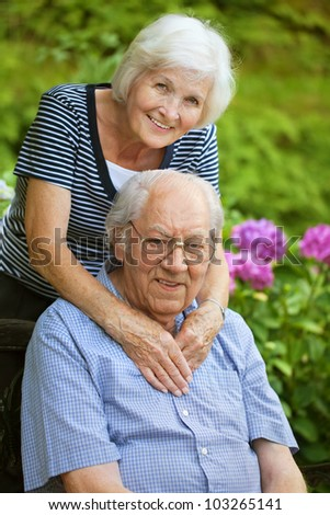 Happy senior couple in the garden - stock photo