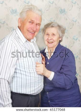 happy senior couple laugh - stock photo
