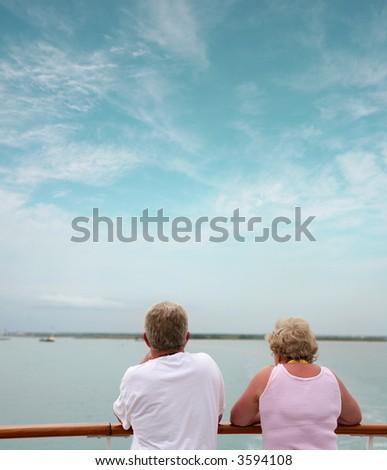 happy senior couple on cruise - stock photo