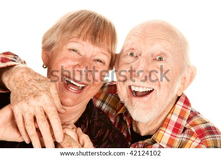 Happy senior couple on white background laughing broadly - stock photo