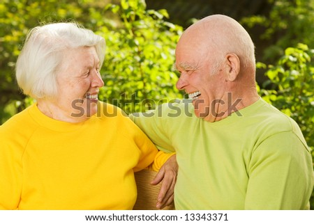 Happy senior couple outdoors - stock photo