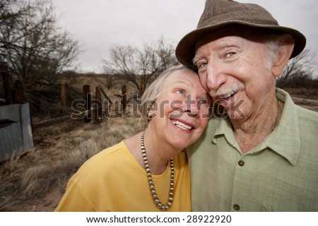 Happy Senior Couple Outdoors Smiling and Embracing