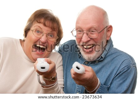 Happy Senior Couple Play Video Game with Remote Controls. - stock photo