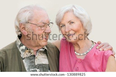 Happy senior couple portrait,outdoors, bright  background - stock photo