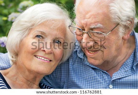 Happy senior couple portrait,outdoors,close-up - stock photo