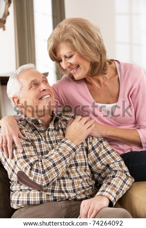 Happy Senior Couple Relaxing At Home - stock photo