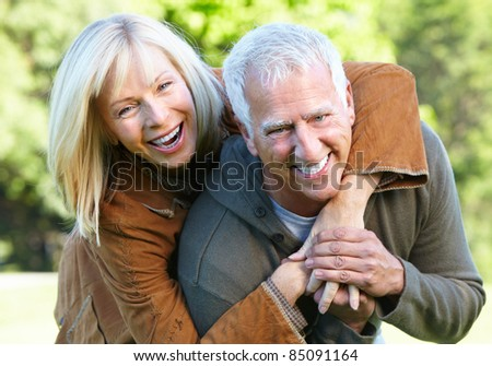 Happy senior couple relaxing in park. Golden age. - stock photo