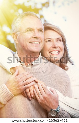 Happy senior couple relaxing in the park. - stock photo