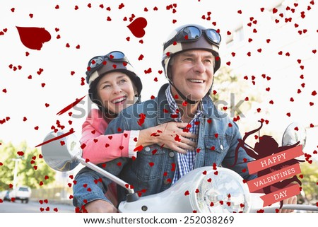 Happy senior couple riding a moped against cute valentines message - stock photo