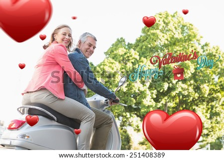 Happy senior couple riding a moped against happy valentines day - stock photo
