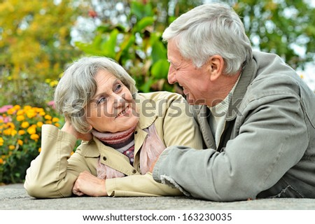 Happy senior couple sitting at table in forest