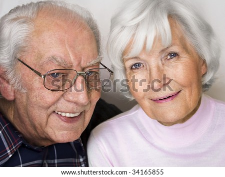 Happy senior couple smiling for a portrait - stock photo