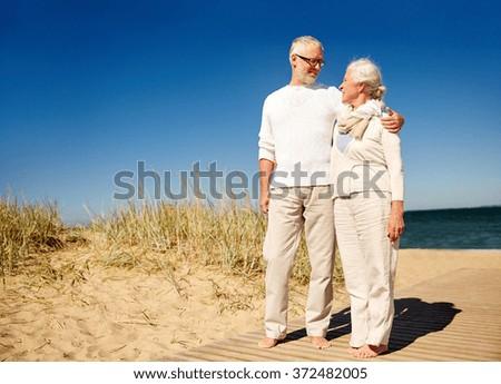 happy senior couple talking outdoors - stock photo