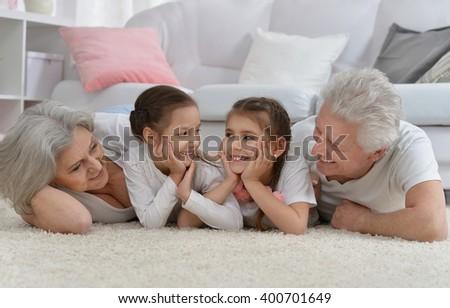 Happy senior couple with grandchildren - stock photo