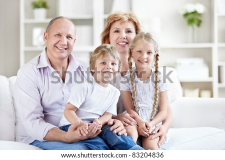 Happy senior couple with grandchildren