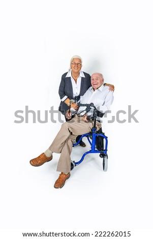 happy senior couple with man in wheelchair - stock photo