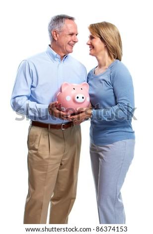 Happy senior couple with piggy bank. Isolated over white background. - stock photo