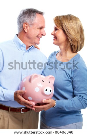 Happy senior couple with piggy bank. Isolated over white background. - stock photo