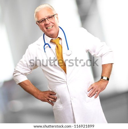 Happy Senior Doctor With Stethoscope, Indoor - stock photo