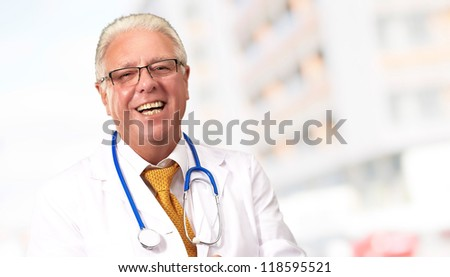 Happy Senior Doctor With Stethoscope, Outdoor - stock photo