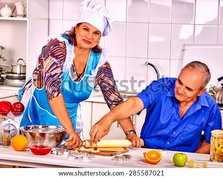 Happy senior family knead dough at kitchen . - stock photo