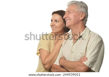 Happy senior father and daughter giving a tenderness hug - stock photo