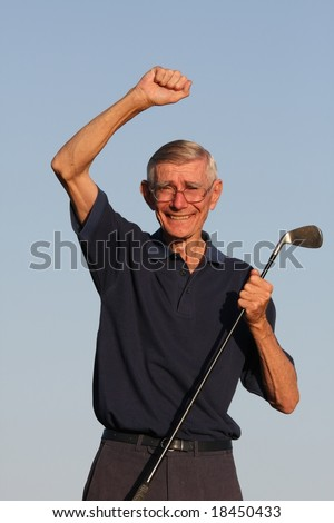 Happy Senior golfer with hand raised and smiling - stock photo