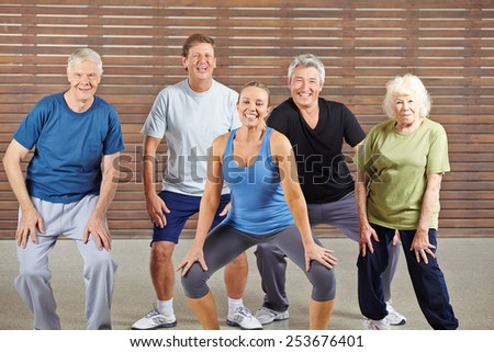 Happy senior group taking dancing lessons together in a gym - stock photo