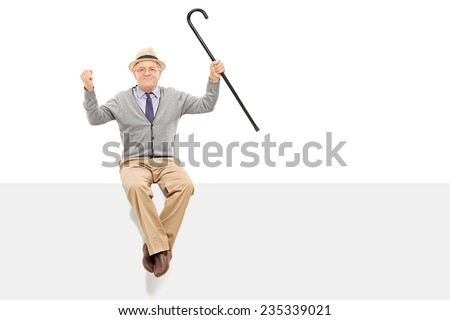 Happy senior holding a cane seated on a panel isolated on white background - stock photo
