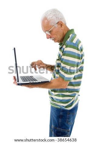 Happy Senior holding a laptop and typing - stock photo