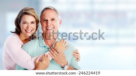 Happy senior loving couple over blue background - stock photo