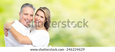 Happy senior loving couple over green nature background - stock photo