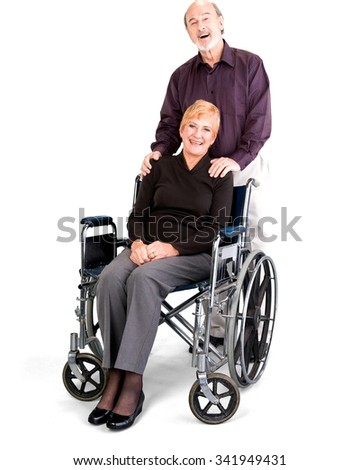 Happy Senior Male & Female Couple with woman in wheelchair in casual outfit - Isolated