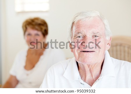 happy senior man and his wife in background - stock photo