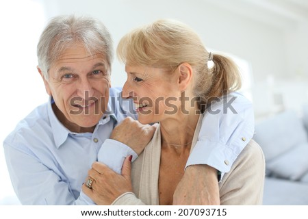 happy senior man embracing his wife - stock photo