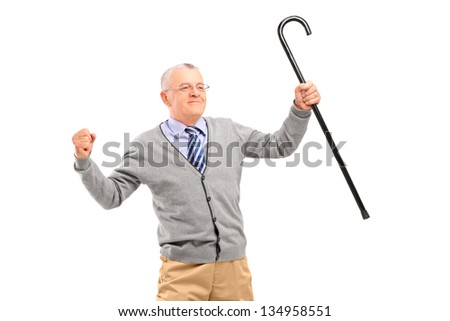 Happy senior man holding a cane and gesturing happiness isolated against white background - stock photo