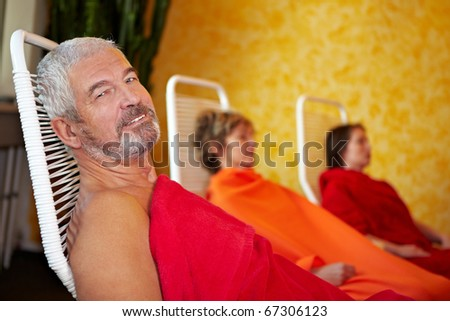 Happy senior man relaxing after spa treatment - stock photo