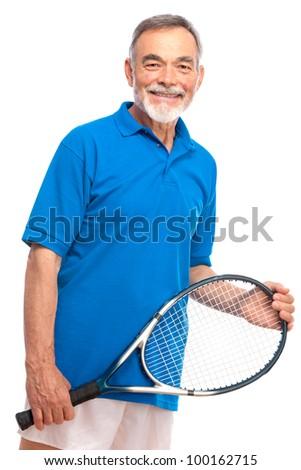 Happy senior man with a tennis racket - stock photo