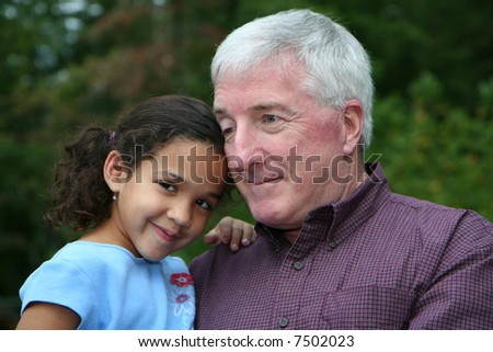 Happy Senior Man with Grandaughter Outside