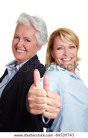 Happy senior mother and adult daughter holding her thumbs up - stock photo