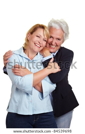 Happy senior mother embracing her smiling daughter - stock photo