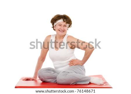 happy senior sport woman sitting on mat - stock photo